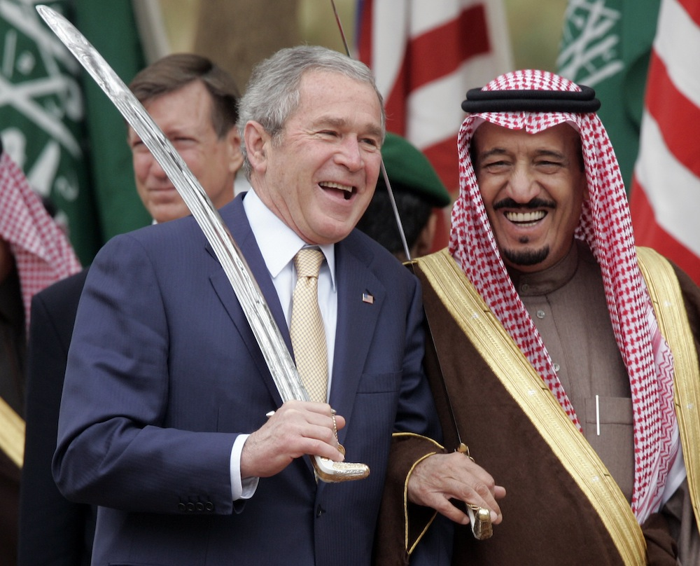 US President Bush, left, shares a laugh with Saudi Prince Salman, brother of Saudi King Abdullah, while watching a traditional sword dance at the Al Murabba Palace and Natural History Muesum in Al Janadriyah, Saudi Arabia, Tuesday, Jan. 15, 2008. (AP Photo/Susan Walsh)