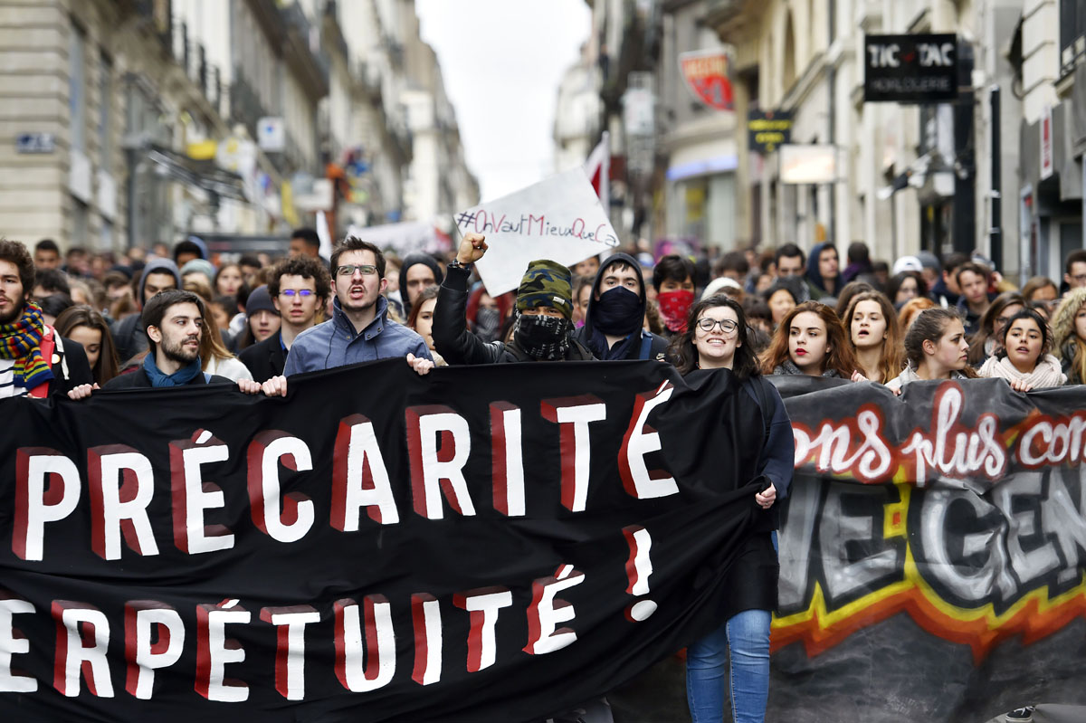 Young people hold a banner as thousands of people demonstrate on March 9, 2016 in Nantes, western France, as part a nationwide day of protest against proposed labour reforms. France faced a wave of protests against deeply unpopular labour reforms that have divided an already-fractured Socialist government and raised hackles in a country accustomed to iron-clad job security. / AFP / LOIC VENANCELOIC VENANCE/AFP/Getty Images ** OUTS - ELSENT, FPG, CM - OUTS * NM, PH, VA if sourced by CT, LA or MoD **