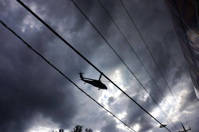Helicopters rained teargas down upon protesters.