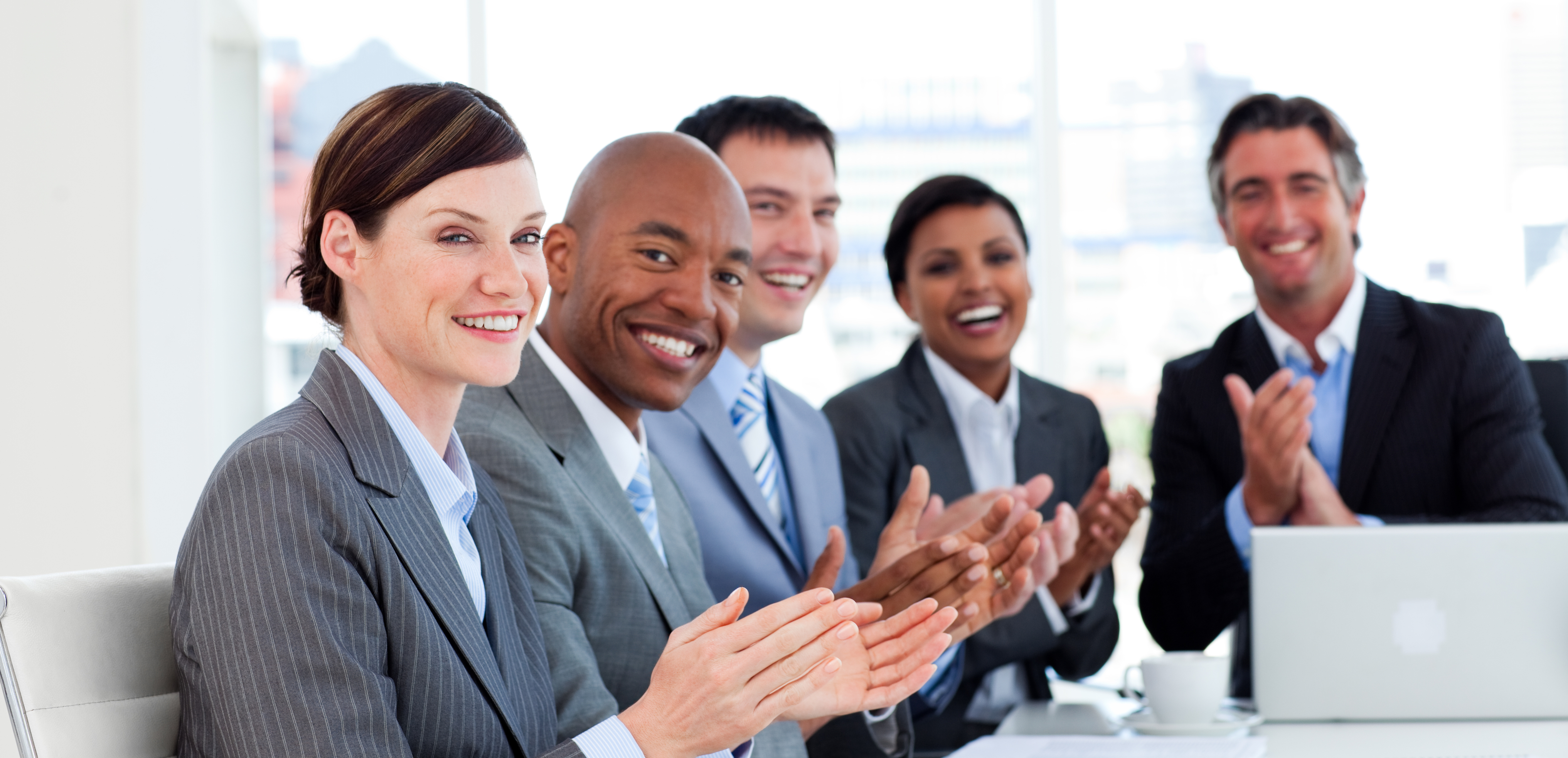 Portrait of an international business team clapping in a meeting